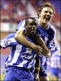 Jimmy Bullard (right) and Henri Camara scored Wigan's goals