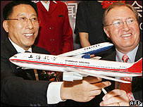 Zhou Chi (L) chairman of Shanghai Airlines, and Glenn Tilton, CEO of United Airlines after signing a new code-sharing agreement and co-operation deal, Shanghai 21 March 2006