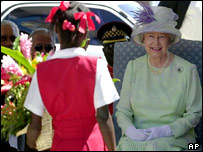 The Queen presented with a bouquet of flowers by Kimberly Black while visiting the Hugh Sherlock Community Center in Kingston on a three-day visit to Jamaica in 2001.