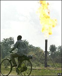 A man riding a bike in the oil-rich Niger Delta in Nigeria