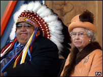 The Queen sits next to Chief Alphonse Bird of the Federation of Indian Nations at the First Nations University in Regina, Canada, in 2005