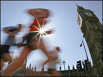 Runners jog past Big Ben at Parliament Square