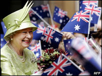 The Queen receives flowers from schoolchildren waving national flags after a Commonwealth Day Service in Sydney