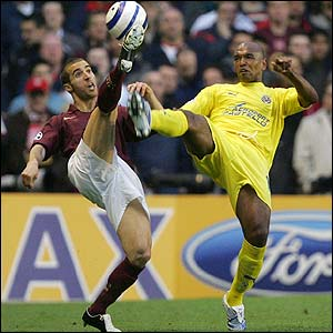 Arsenal's Matthieu Flamini competes with Marcos Senna