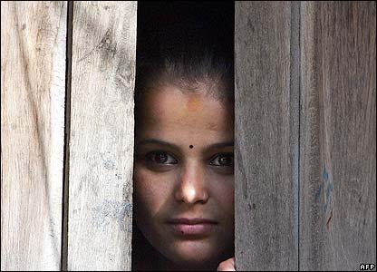 Kathmandu woman peers outside