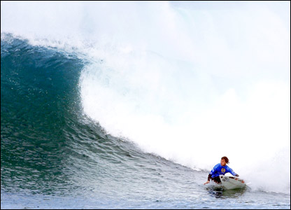 Australian surfer Mark Occhilupo prepares to ride a wave