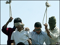 Mahmoud Asgari, 16, left, and another teenager at their public hanging in Iran in July 2005