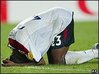 Darius Vassell collapses in defeat