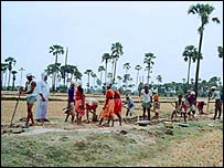 Villagers building a canal in India