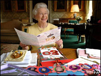 The Queen examined the messages of goodwill, including scores of colourful home-made cards, from around the world, in the palace's Regency Room