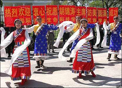 Supporters of the Chinese president dance outside the White House.
