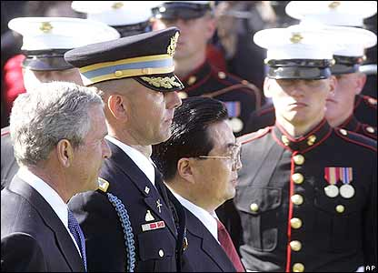 President Bush and President Jintao review the troops