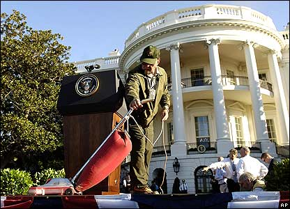 A National Park Service worker vacuums the stage on the White House South Lawn.