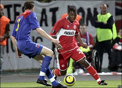 Yakubu comes up against Dorin Goian