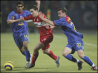 Middlesbrough winger Stewart Downing (centre) is quickly closed down by the Steaua players