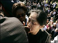 Secret Service officer covers the mouth of protester Wenyi Wang