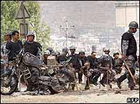 Riot policemen rest near Kalanki, Kathmandu