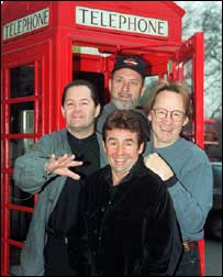 Outside a British phonebox while on the Monkees reunion tour of 1997