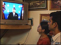 Nepalese viewers watch the king's televised address