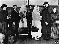 A group of immigrants arriving at Ellis Island in New York