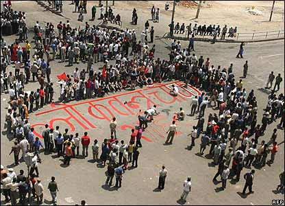 Nepalese protesters paint a junction in Kalanki district of Kathmandu
