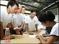 Chinese community members register at secure camp in Honiara