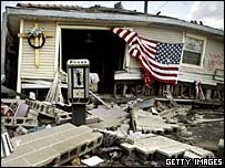 Damaged house flying the American flag in New Orleans
