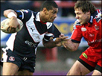 Leon Pryce (L) of St Helens tries to get through the Salford defence