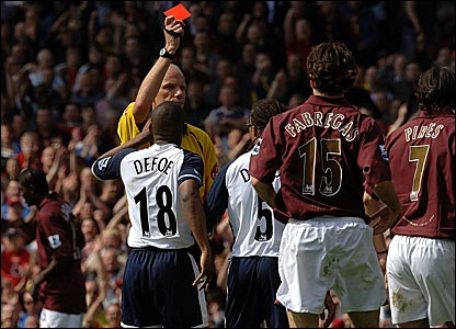 Referee Steve Bennett shows Edgar Davids a red card