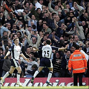 Robbie Keane (left) celebrates his goal in front of the ecstatic away fans