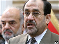 Incoming Iraqi PM Maliki, and outgoing interim PM Jaafari (background, left)