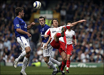Birmingham's Kenny Cunningham (right) clears under pressure from James Beattie (left)