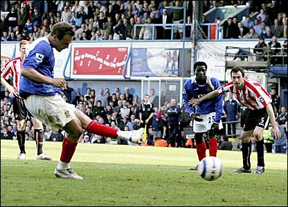 Matthew Taylor scores a late penalty to win the game for Portsmouth