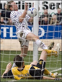 Noel Hunt guides the ball into the net for the winner