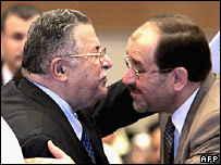 Mr Talabani (left) congratulates Mr Maliki on his nomination