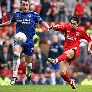 Luis Garcia (right) holds off the attentions of John Terry to score