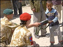 British troops distribute gifts to an Afghan boy