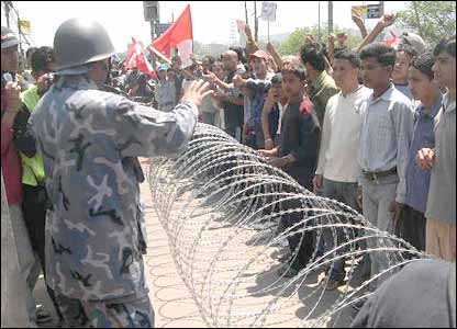 Police confront protesters over a barbed wire cordon