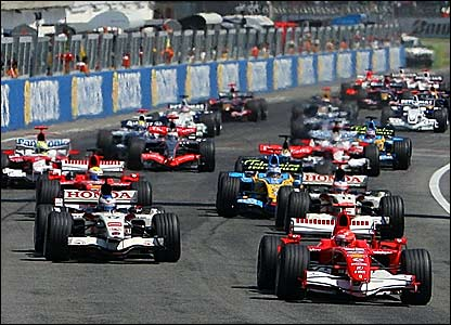 Michael Schumacher (right) leads the San Marino Grand Prix going into the first corner