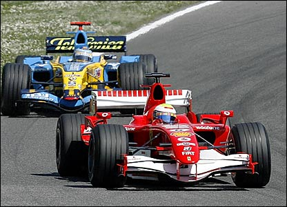Ferrari's Felipe Massa fends off the challenge of Renault's Fernando Alonso