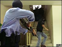 Hamas gunmen take up positions in the health ministry in Gaza City on Sunday
