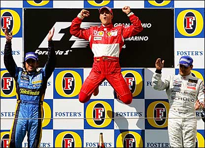 Fernando Alonso (left), Michael Schumacher (centre) and Juan Pablo Montoya on the podium at Imola
