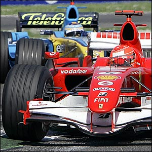 Michael Schumacher leads from Fernando Alonso