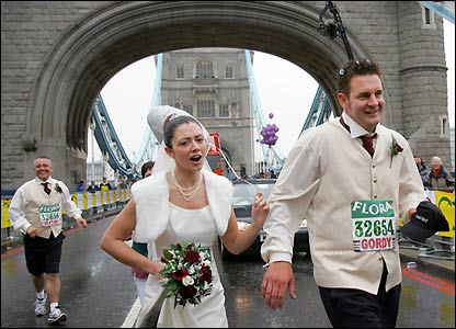 The newlyweds continue their race with the bride's father close behind