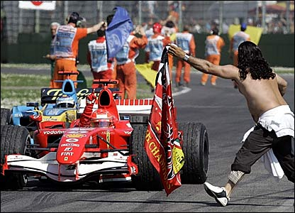 A Ferrari fans holds out a flag for Michael Schumacher