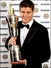 Steven Gerrard holds aloft his PFA award