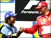 Fernando Alonso congratulates rival Michael Schumacher after his win