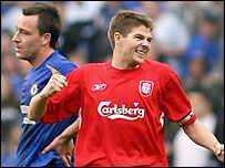 Liverpool's Steven Gerrard (right) celebrates beating Chelsea while John Terry looks dejected