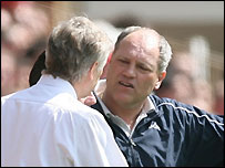Arsenal manager Arsene Wenger (left) argues with Tottenham coach Martin Jol