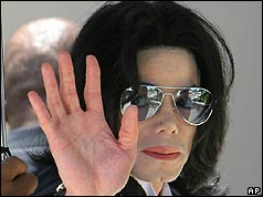 Michael Jackson waves to supporters
